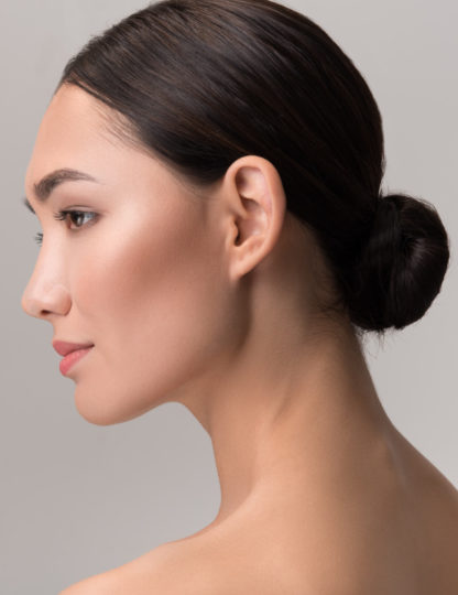 woman with her hair in a bun