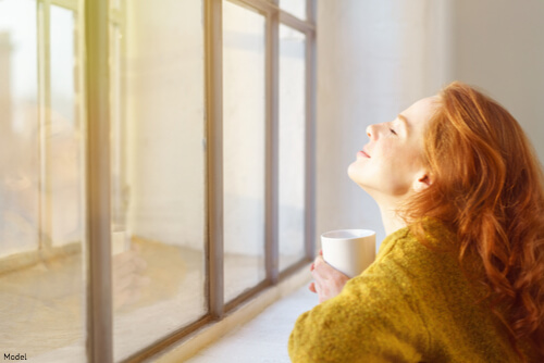 Woman looking out her window