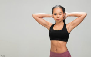 Woman wearing workout clothes and looking slim
